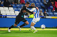 Kristoffer Peterson of Swansea City vies for possession with Juninho Bacuna of Huddersfield Town during the Sky Bet Championship match between Huddersfield Town and Swansea City at The John Smith's Stadium in Huddersfield, England, UK. Tuesday 26 November 2019
