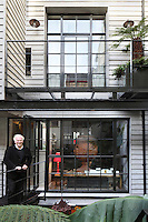 Architect Chris Dyson at the rear of his home in Spitalfields overlooking the patio garden