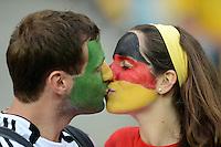 FUSSBALL  EUROPAMEISTERSCHAFT 2012   VORRUNDE Deutschland - Portugal          09.06.2012 Ein maennlicher Fan mit portugiesischer Gesichtsbemalung kuesst ein weiblichen Fan mit deutscher Gesichtsbemalung