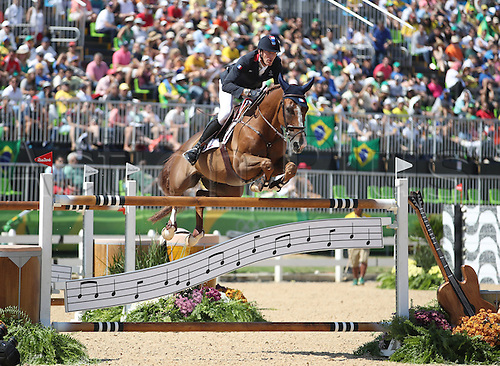 14.08.2016. Rio de Janeiro, Brazil. Kevin Staut of France on horse Reveur De Hurtebise clears an obstacle during the Jumping Individual 1st Qualifier of the Equestrian competition at the Olympic Equestrian Centre during the Rio 2016 Olympic Games in Rio de Janeiro, Brazil, 14 August 2016.