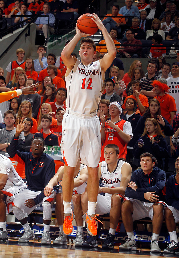 Virginia guard Joe Harris (12) shoots a 3-point basket during the game Wednesday in Charlottesville, VA. Virginia defeated Tennessee 46-38.