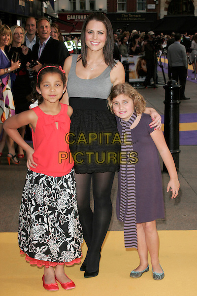 """SUSIE AMY & GIRLS.UK Premiere of """"Hannah Montana: The Movie"""" at the Odeon Leicester Square, London, England. .April 23rd 2009 .full length grey gray black dress white pattern skirt red top scarf striped stripes kids children guests hand on hip.CAP/AH.©Adam Houghton/Capital Pictures."""