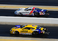 Apr. 13, 2012; Concord, NC, USA: NHRA pro stock driver Jeg Coughlin (near lane) races alongside Ron Krisher during qualifying for the Four Wide Nationals at zMax Dragway. Mandatory Credit: Mark J. Rebilas-