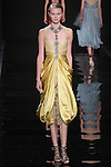 "Model walks runway in a saffron silk charmeuse dress with lace underpinning from the Reem Acra Fall 2016 ""The Secret World of The Femme Fatale"" collection, at NYFW: The Shows Fall 2016, during New York Fashion Week Fall 2016."