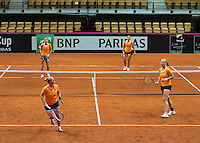 13 April, 2016, France, Trélazé, Arena Loire,   Semifinal FedCup, France-Netherlands, Dutch team practise, doubles, Kiki Bertens forground right with Richel Hogenkamp,  on the other side of the net Arantxa Rus (L) and Cindy Burger<br /> Photo: Henk Koster/tennisimages