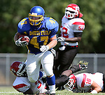 MADISON, SD - AUGUST 30: Joe Whealy of Dakota State University rumbles past Billy Reddick #3, and Ryan Parks #18 of Bacone College in the second quarter of their game Saturday afternoon at Trojan Field in Madison. (photo by Dave Eggen/Inertia)
