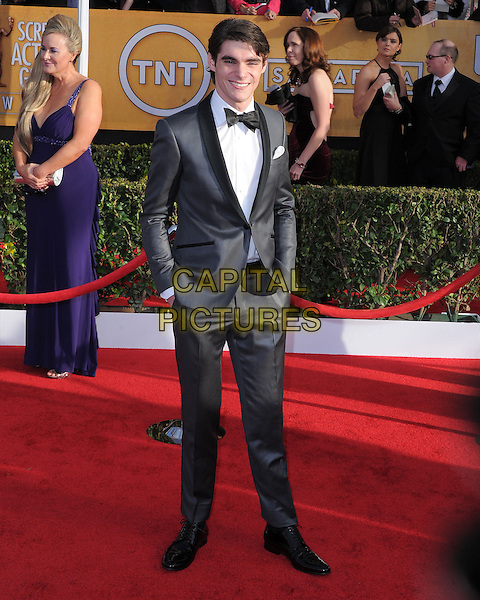 RJ Mitte.Arrivals at the 19th Annual Screen Actors Guild Awards at the Shrine Auditorium in Los Angeles, California, USA..27th January 2013.SAG SAGs full length black white grey gray shirt bow tie tuxedo hands in pockets .CAP/DVS.©DVS/Capital Pictures.