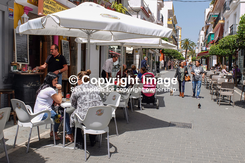 Pedestrianized street, cafes, bars, San Pedro de Alcantara, Spain, April, 2017, 201704233509<br /> <br /> Copyright Image from Victor Patterson, 54 Dorchester Park, <br /> Belfast, UK, BT9 6RJ<br /> <br /> t1: +44 28 9066 1296 (from Rep of Ireland 048 9066 1296)<br /> t2: +44 28 9002 2446 (from Rep of Ireland 048 9002 2446)<br /> m: +44 7802 353836<br /> <br /> e1: victorpatterson@me.com<br /> e2: victorpatterson@gmail.com<br /> <br /> www.victorpatterson.com<br /> <br /> Please see my Terms and Conditions of Use at www.victorpatterson.com. It is IMPORTANT that you familiarise yourself with them.<br /> <br /> Images used on the Internet must be visibly watermarked i.e. &copy; Victor Patterson within the body of the image and copyright metadata must not be deleted. Images used on the Internet have a size restriction of 4kbs and will be chargeable at current NUJ rates unless agreed otherwise.<br /> <br /> This image is only available for the use of the download recipient i.e. television station, newspaper, magazine, book publisher, etc, and must not be passed on to any third party. It is also downloaded on condition that each and every usage is notified within 7 days to victorpatterson@me.com<br /> <br /> The right of Victor Patterson to be identified as the author is asserted in accordance with The Copyright Designs And Patents Act (1988).