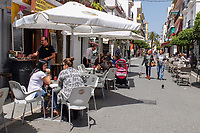 Pedestrianized street, cafes, bars, San Pedro de Alcantara, Spain, April, 2017, 201704233509<br /> <br /> Copyright Image from Victor Patterson, 54 Dorchester Park, <br /> Belfast, UK, BT9 6RJ<br /> <br /> t1: +44 28 9066 1296 (from Rep of Ireland 048 9066 1296)<br /> t2: +44 28 9002 2446 (from Rep of Ireland 048 9002 2446)<br /> m: +44 7802 353836<br /> <br /> e1: victorpatterson@me.com<br /> e2: victorpatterson@gmail.com<br /> <br /> www.victorpatterson.com<br /> <br /> Please see my Terms and Conditions of Use at www.victorpatterson.com. It is IMPORTANT that you familiarise yourself with them.<br /> <br /> Images used on the Internet must be visibly watermarked i.e. © Victor Patterson within the body of the image and copyright metadata must not be deleted. Images used on the Internet have a size restriction of 4kbs and will be chargeable at current NUJ rates unless agreed otherwise.<br /> <br /> This image is only available for the use of the download recipient i.e. television station, newspaper, magazine, book publisher, etc, and must not be passed on to any third party. It is also downloaded on condition that each and every usage is notified within 7 days to victorpatterson@me.com<br /> <br /> The right of Victor Patterson to be identified as the author is asserted in accordance with The Copyright Designs And Patents Act (1988).
