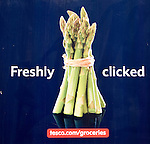 Bunch of asparagus picture freshly clicked logo on Tesco delivery van, UK