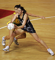 16.11.2007 Australian Mo'onia Gerrard and Silver Ferns Jodi Te Huna in action during the Silver Ferns v Australia Final at the New World Netball World Champs held at Trusts Stadium Auckland New Zealand. Mandatory Photo Credit ©Michael Bradley.