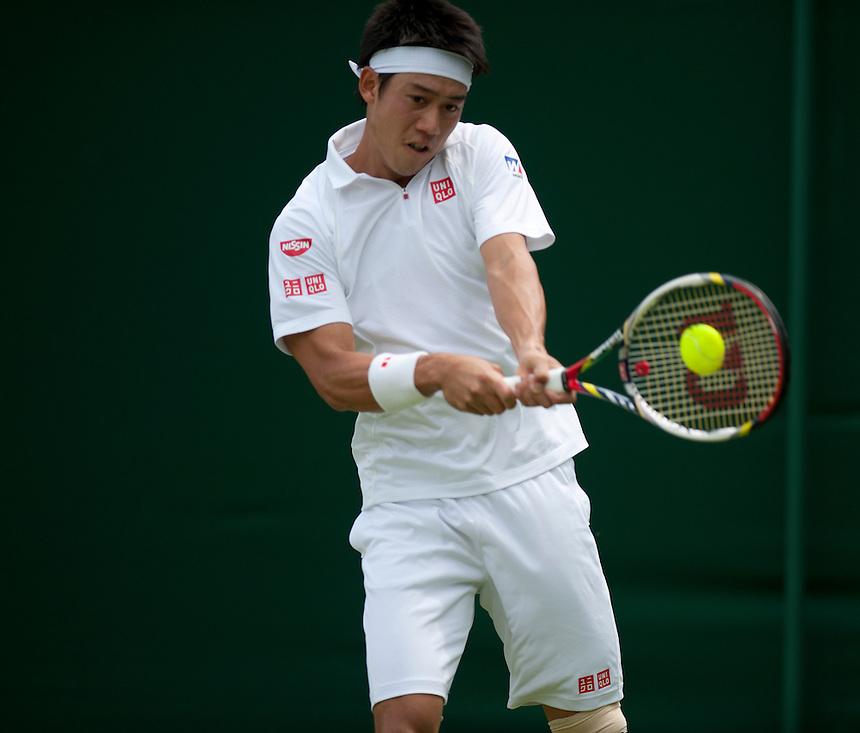 Kei Nishikori (JPN) [12] in action during his victory over Matthew Ebden (AUS) in their Gentlemen's Singles First Round match today - Kei Nishikori (JPN) [12] def Matthew Ebden (AUS) 6-2 6-4 6-3<br /> <br />  (Photo by Stephen White/CameraSport) <br /> <br /> Tennis - Wimbledon Lawn Tennis Championships - Day 2 Tuesday 25th June 2013 -  All England Lawn Tennis and Croquet Club - Wimbledon - London - England<br /> <br /> &copy; CameraSport - 43 Linden Ave. Countesthorpe. Leicester. England. LE8 5PG - Tel: +44 (0) 116 277 4147 - admin@camerasport.com - www.camerasport.com.