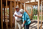 John and Brenda English stand in their home in Vaughn, Georgia after an April tornado tore apart the community, as well as their home, which is currently being rebuilt with the help of family.