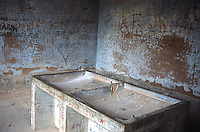 Graffitti covers the walls of an abandoned hospital laundry room in Vallegrande, Bolivia Saturday, Nov. 13, 2004, where the body of the executred Ernesto &quot;Che&quot; Guevara was put on public display. Guevara was captured by the Bolivian army in 1967 in a nearby valley and executed in La Higuera days later. Guevara and fellow communist guerillas were attempting to launch a continent-wide revolution modeled on Guevara's success in Cuba in the late 1950s. The Bolivian government recently began promoting the area where he fought, was captured, killed and burried for 30 years as the &quot;Ruta del Che,&quot; or Che's Route. (Kevin Moloney for the New York Times) <br />