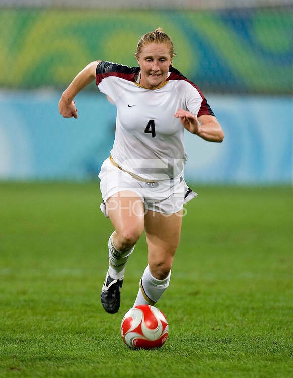 Rachel Buehler. The USWNT defeated New Zealand, 4-0, during the 2008 Beijing Olympics in Shenyang, China.  With the win, the USWNT won group G and advanced to the semifinals.
