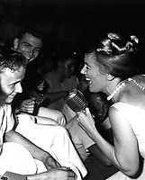 "Twenty-one year old James R. Gould is the envy of 3,000 crewmemberrs as television actress Kathleen Nolan singles him out for a song.  The young sailor and Bon Homme Richard both celebrated their ""coming of age"" on November 26, 1965. (USIA)<br /> NARA FILE #:  306-MVP-8-6<br /> WAR & CONFLICT BOOK #:  392"