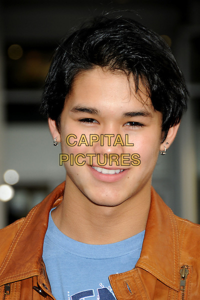 "BOOBOO STEWART .""A Nightmare On Elm Street"" Los Angeles Premiere held at Grauman's Chinese Theatre, Hollywood, California, USA, 27th April 2010..portrait headshot smiling blue  brown tan leather .CAP/ADM/BP.©Byron Purvis/AdMedia/Capital Pictures."