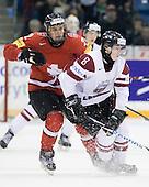 Nino Niederreiter (Switzerland - 22), Janis Smits (Latvia - 8) - Team Switzerland defeated Team Latvia 7-5 on Wednesday, December 30, 2009, at the Credit Union Centre in Saskatoon, Saskatchewan, during the 2010 World Juniors tournament.