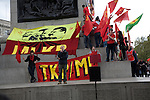 May Day march and rally at Trafalgar Square, May 1st, 2010 banners and red flags on Nelson's Column
