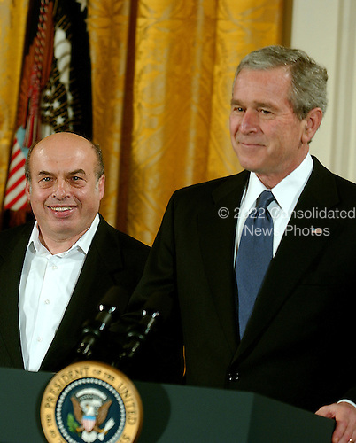 Washington, D.C. - December 15, 2006 -- Natan Sharansky  smiles as United States President George W. Bush arrives prior to receiving the Presidential Medal of Freedom from the President and first lady Laura Bush during a ceremony in the East Room of the White House on Friday, December 15, 2006.  The medal is the nation's highest civil award.  It may be awarded &quot;to any person who has made an especially meritorious contribution to (1) the security or national interests of the United States, or, (2) world peace, or (3) cultural or other significant public or private endeavors&quot;.  Natan Sharansky&rsquo;s life is the story of good conquering evil and an illustration of the strength of the human spirit.  Imprisoned by the Soviet regime for his work to advance religious liberty and human rights, he spent nine years in the gulag.  Following his immigration to Israel, he served with distinction in that nation&rsquo;s government.  He remains a powerful champion of the principles that all people deserve to live in freedom and that the advance of liberty is critical to peace and security around the world.  The United States honors Natan Sharansky for his contributions to and sacrifices for the cause of democracy and freedom.<br /> Credit: Ron Sachs / CNP