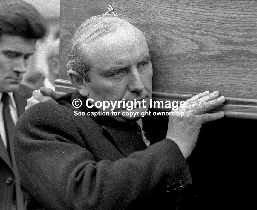 Irish Justice Minister, Patrick Cooney, carrying coffin at the funeral of Senator Billy Fox, 35 years, Protestant, Fine Gael politician, Co Monaghan, Rep of Ireland, 14th March 1974. He was previously a TD (Irish MP).  Fox was visiting the home near Clones of his fiancee, Marjorie Coulson, which unknown to him had been taken over by thirteen armed paramilitaries. He ran from the scene but was followed and shot dead in a nearby field. Five members of the Provisional IRA were subsequently tried and convicted of the killing. 197403140164d. <br /> <br /> Copyright Image from Victor Patterson,<br /> 54 Dorchester Park, <br /> Belfast, UK, BT9 6RJ<br /> <br /> t1: +44 28 9066 1296 (from Rep of Ireland 048 9066 1296)<br /> t2: +44 28 9002 2446 (from Rep of Ireland 048 9002 2446)<br /> <br /> m: +44 7802 353836<br /> <br /> e: victorpatterson@me.com<br /> www.victorpatterson.com<br /> <br /> Please see my Terms and Conditions of Use at www.victorpatterson.com. It is IMPORTANT that you familiarise yourself with them.<br /> <br /> Images used on the Internet must be visibly watermarked i.e. &copy; Victor Patterson<br /> within the body of the image and copyright metadata must not be deleted. Images <br /> used on the Internet have a size restriction of 4kbs and will be chargeable at current<br />  NUJ rates unless agreed otherwise.<br /> <br /> This image is only available for the use of the download recipient i.e. television station, newspaper, magazine, book publisher, etc, and must not be passed on to any third <br /> party. It is also downloaded on condition that each and every usage is notified within 7 days to victorpatterson@me.com<br /> <br /> The right of Victor Patterson to be identified as the author is asserted in accordance with The Copyright Designs And Patents Act (1988). All moral rights are asserted.<br /> l