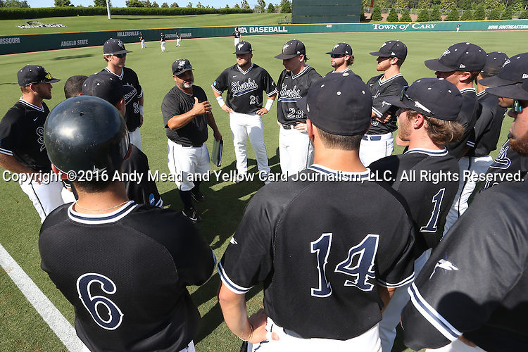 28 May 2016: Assistant coach Eric Cruz talks to the players before the game. The Nova Southeastern University Sharks played the Franklin Pierce University Ravens in Game 3 of the 2016 NCAA Division II College World Series  at Coleman Field at the USA Baseball National Training Complex in Cary, North Carolina. Nova Southeastern won the game 4-3 in twelve innings.