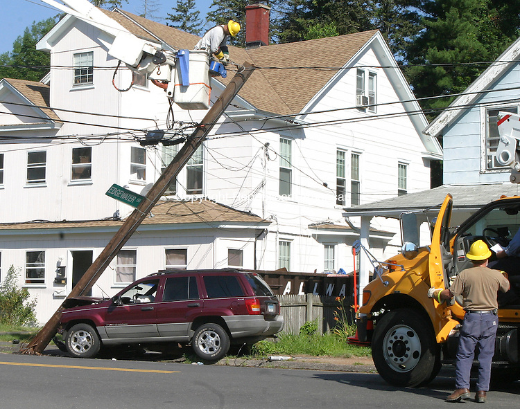 WATERBURY CT.- 06 JULY  2011  070611DA02- CL&amp;P employee works on a utility pole after a vehicle drove into the pole knocking out power on Edgewood Ave. in Waterbury Wednesday morning.<br /> Darlene Douty Republican American