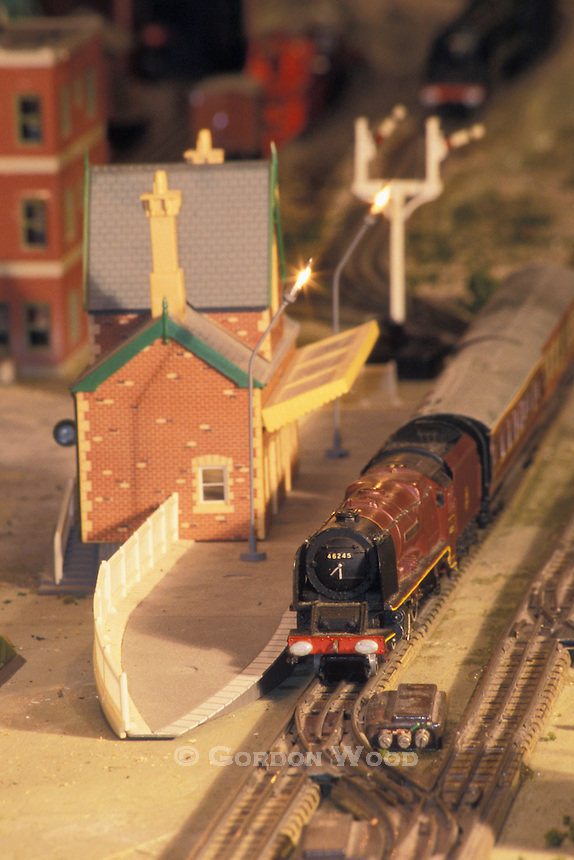 Antique British Model Train Stopped at Railway Station