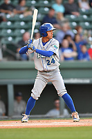 Center fielder Marten Gasparini (24) of the Lexington Legends bats in a game against the Greenville Drive on Wednesday, April 12, 2017, at Fluor Field at the West End in Greenville, South Carolina. Greenville won, 4-1. (Tom Priddy/Four Seam Images)