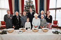 21/12/2019 - Undated photograph released by Buckingham Palace of Queen Elizabeth II, Prince Charles Prince of Wales, Prince William Duke of Cambridge and Prince George, alongside (left to right) veterans Liam Young, Colin Hughes, Alex Cavaliere, Barbra Hurman and Lisa Evans, in the Music Room at Buckingham Palace, London, as part of the launch of The Royal British Legion's Together at Christmas initiative. Photo Credit: ALPR/AdMedia