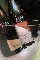 Bottles in ice bucket. Montlouis dur Loire Les Choisilles, Francois Chidaine, Montlouis sur Loire, France