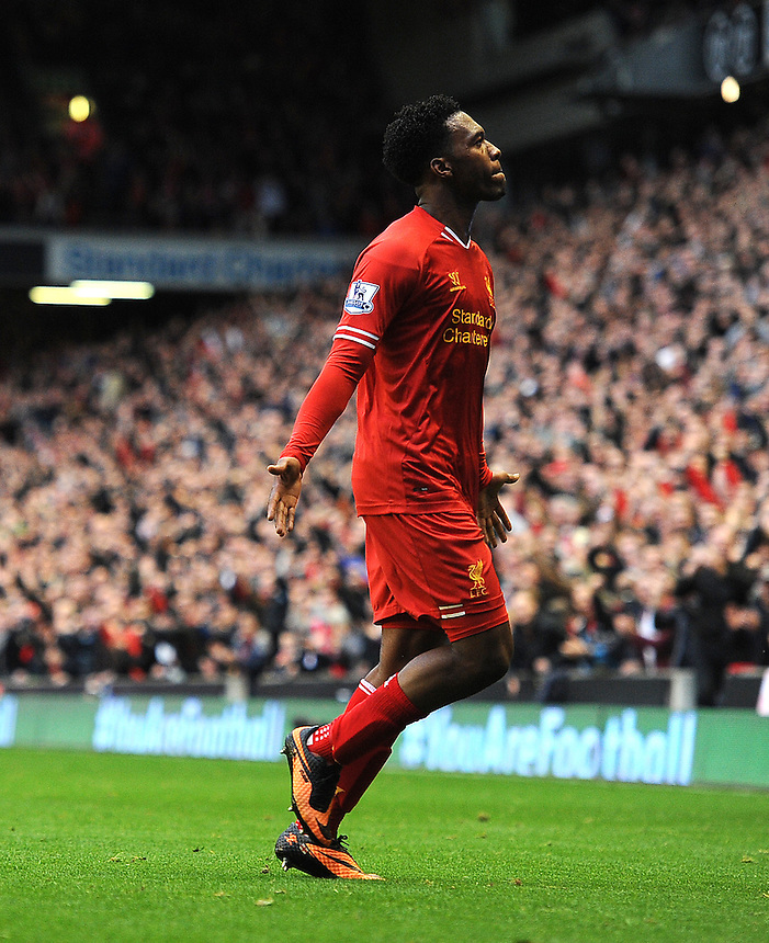 Liverpool's Daniel Sturridge celebrates scoring his sides fourth goal <br /> <br /> Photo by Stephen White/CameraSport<br /> <br /> Football - Barclays Premiership - Liverpool v West Bromwich Albion - Saturday 26th October 2013 - Anfield - Liverpool<br /> <br /> &copy; CameraSport - 43 Linden Ave. Countesthorpe. Leicester. England. LE8 5PG - Tel: +44 (0) 116 277 4147 - admin@camerasport.com - www.camerasport.com