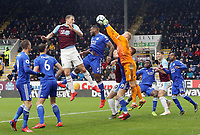 Leicester City's Kasper Schmeichel punches clear under pressure from Burnley's Chris Wood<br /> <br /> Photographer Rich Linley/CameraSport<br /> <br /> The Premier League - Burnley v Leicester City - Saturday 16th March 2019 - Turf Moor - Burnley<br /> <br /> World Copyright © 2019 CameraSport. All rights reserved. 43 Linden Ave. Countesthorpe. Leicester. England. LE8 5PG - Tel: +44 (0) 116 277 4147 - admin@camerasport.com - www.camerasport.com