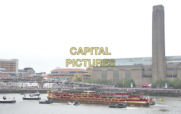 The Spirit of Chartwell.sailing ( past the Tate Gallery & Millenium Bridge ) as part of the Diamond Jubilee River Pageant, River Thames, London, England..June 3rd, 2012.gv general view water river building flags ship boat crowds  .CAP/CAN.©Can Nguyen/Capital Pictures.