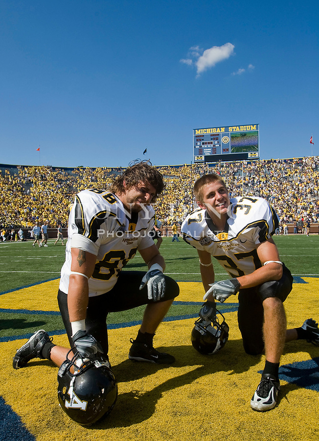 1 September 2007: Appalachian State tight end Nic Cardwell (88) and wide receiver Blake Elder (37) share a moment reflecting on their 2007 season opener college football game against the Michigan Wolverines at Michigan Stadium in Ann Arbor, MI. Appalachian Sate upset no. 5 ranked Michigan 34-32.