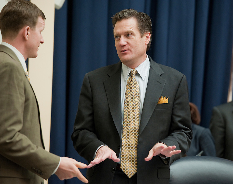 "UNITED STATES - MARCH 01:  Rep. Mike Turner, R-Ohio, center, talks with an aide before a House Armed Services Committee hearing in Rayburn entitled ""FY2013 National Defense Authorization Budget Request from U.S. Pacific Command."" (Photo By Tom Williams/CQ Roll Call)"