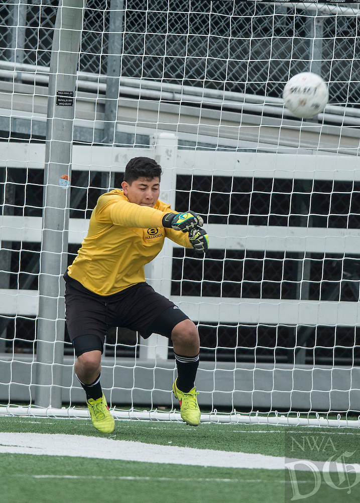 NWA Democrat-Gazette/ANTHONY REYES &bull; @NWATONYR<br /> Hugo Rodriguez, Springdale goal, knocks the ball away against Fort Smith Northside Thursday, March 19, 2015 at Bulldog Stadium in Springdale. The Bulldogs won on penalty kicks after a 2-2 tie at the end of regulation.