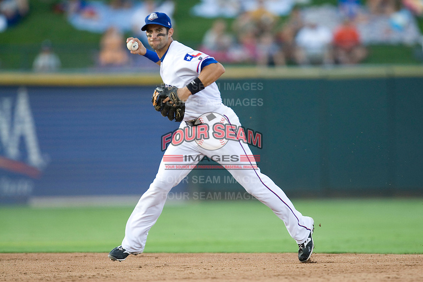 Round Rock Express second baseman Matt Kata #15 makes a running throw to first base during a game against the New Orleans Zephyrs at the Dell Diamond on July 21, 2011 in Round Rock, Texas.  New Orleans defeated Round Rock 7-4.  (Andrew Woolley/Four Seam Images)