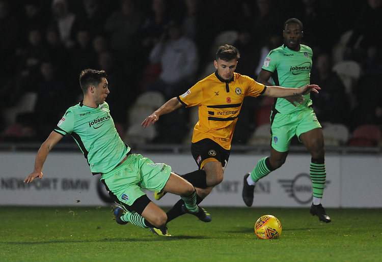 Newport County's Mark Harris vies for possession with Colchester United's Luke Prosser<br /> <br /> Photographer Kevin Barnes/CameraSport<br /> <br /> The EFL Sky Bet League Two - Newport County v Colchester United - Saturday 17th November 2018 - Rodney Parade - Newport<br /> <br /> World Copyright © 2018 CameraSport. All rights reserved. 43 Linden Ave. Countesthorpe. Leicester. England. LE8 5PG - Tel: +44 (0) 116 277 4147 - admin@camerasport.com - www.camerasport.com