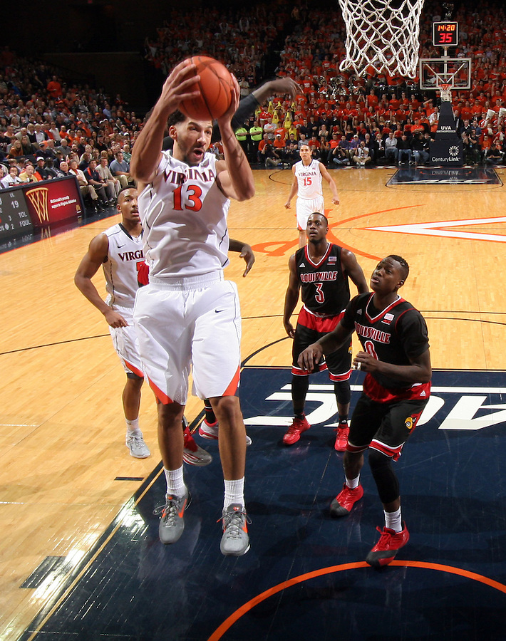 Virginia forward Anthony Gill (13) during the game Saturday Feb. 7, 2015, in Charlottesville, Va. Virginia defeated Louisville  52-47. (Photo/Andrew Shurtleff)