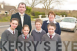 SLOW DOWN: Staff and pupils of Curraheen school in Glenbeigh, who want more traffic calming measures put in place at the school, front l-r: Kate Roche, Cathriona Walsh, Aaron Mulvihill, Danielle O'Connor. Back l-r: Cllr Michael Cahill, Helen Murphy (Principal).