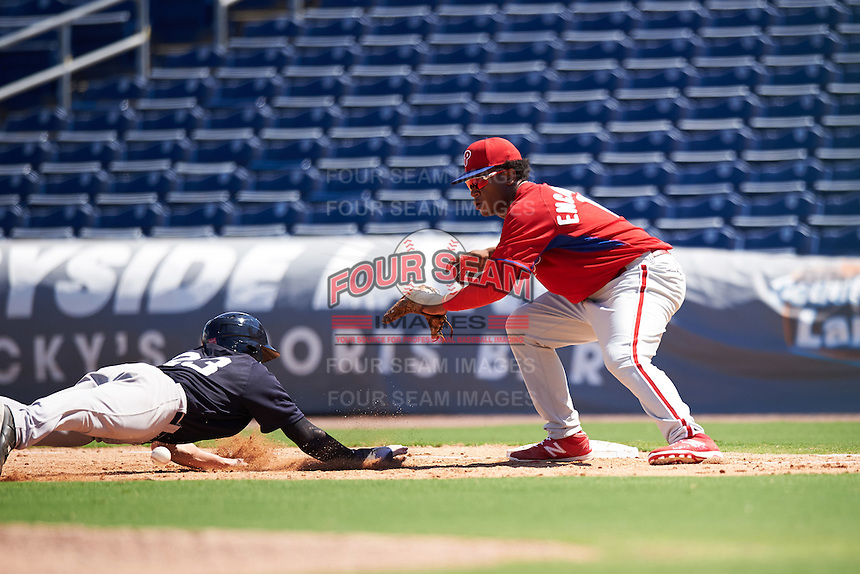 Philadelphia Phillies Luis Encarnacion (18) stretches for a throw as Kyle Holder (23) dives back to first base during an Instructional League game against the New York Yankees on September 27, 2016 at Bright House Field in Clearwater, Florida.  (Mike Janes/Four Seam Images)