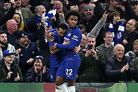 Willian congratulates Pedro after scoring Chelsea's opening goal during Chelsea vs Newcastle United, Premier League Football at Stamford Bridge on 12th January 2019