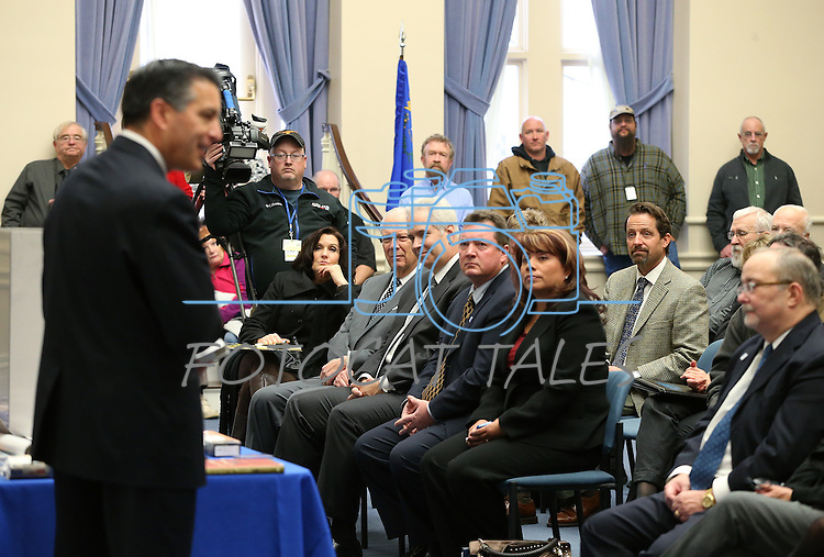Gov. Brian Sandoval speaks at a ceremony to place items in the NV150 time capsule at the Capitol, in Carson City, Nev., on Monday, Dec. 15, 2014. The capsule, containing 45 items related to the Sesquicentennial, is set to be opened in 2064.<br /> Photo by Cathleen Allison
