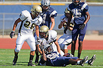 Torrance, CA 09/08/11 - James Nelson (Peninsula #26), unidentified Peninsula player and unidentified North players in action during the North-Peninsula Junior Varsity Football game at North High School in Torrance.