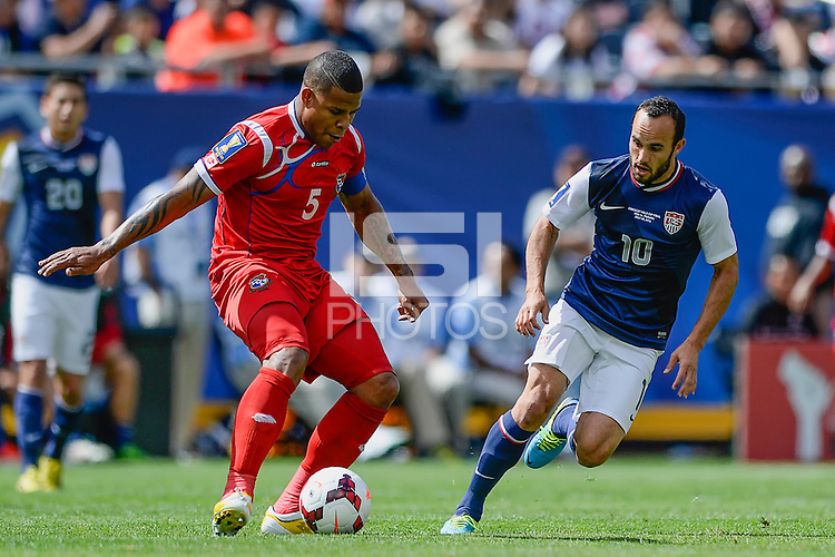 Chicago, IL - Sunday July 28, 2013:  USMNT Landon Donovan (10) chases after the ball with Panama's Roman Torres (5) during the CONCACAF Gold Cup Finals soccer match between the USMNT and Panama, at Soldier Field in Chicago, IL.