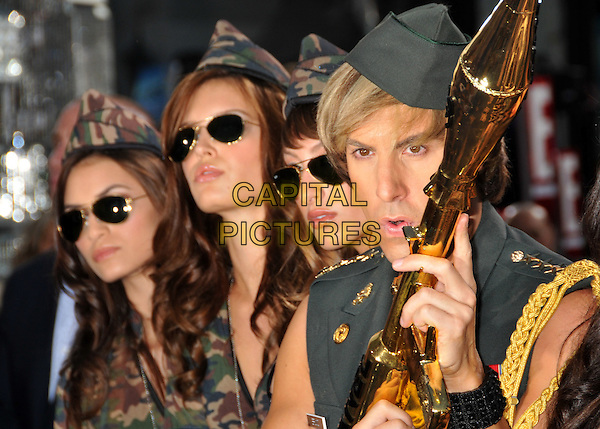 "SACHA BARON COHEN.""Bruno"" Los Angeles Premiere held at Grauman's Chinese Theatre, Hollywood, CA, USA..June 25th, 2009 .half length army green uniform military gold chanel bazooka rocket launcher gun posing hat .CAP/ADM/BP.©Byron Purvis/AdMedia/Capital Pictures."