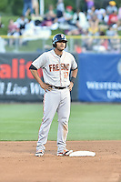 Chris Dominguez (17) of the Fresno Grizzlies at second base during the game against the Salt Lake Bees at Smith's Ballpark on May 25, 2014 in Salt Lake City, Utah.  (Stephen Smith/Four Seam Images)
