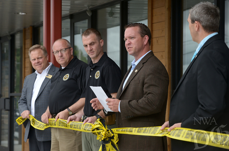 NWA Democrat-Gazette/BEN GOFF @NWABENGOFF<br /> Benton County Sheriff Shawn Holloway (second from right) makes remarks Thursday, June 22, 2017, during a grand opening for the new Benton County Sheriff's Office Prairie Creek substation on Arkansas highway 12 near Beaver Lake. The new 1,500 square foot facility will have space for deputies and Arkansas Game and Fish Commission officers to work and store equipment. The sheriff's office already has substations in Siloam Springs, Gravette and Avoca.