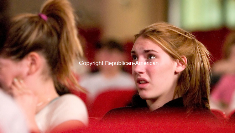 SOUTHBURY, CT- 12 APRIL 07- 041207JT04- <br /> Layla Longo, 15, reacts to images shown during a presentation titled &quot;DUI: The Hard Truth&quot; at Pomperaug High School on Thursday evening. Ralph Anthony Miro, a career paramedic, presented the program to show teens the ramifications of drinking and driving.<br /> Josalee Thrift Republican-American